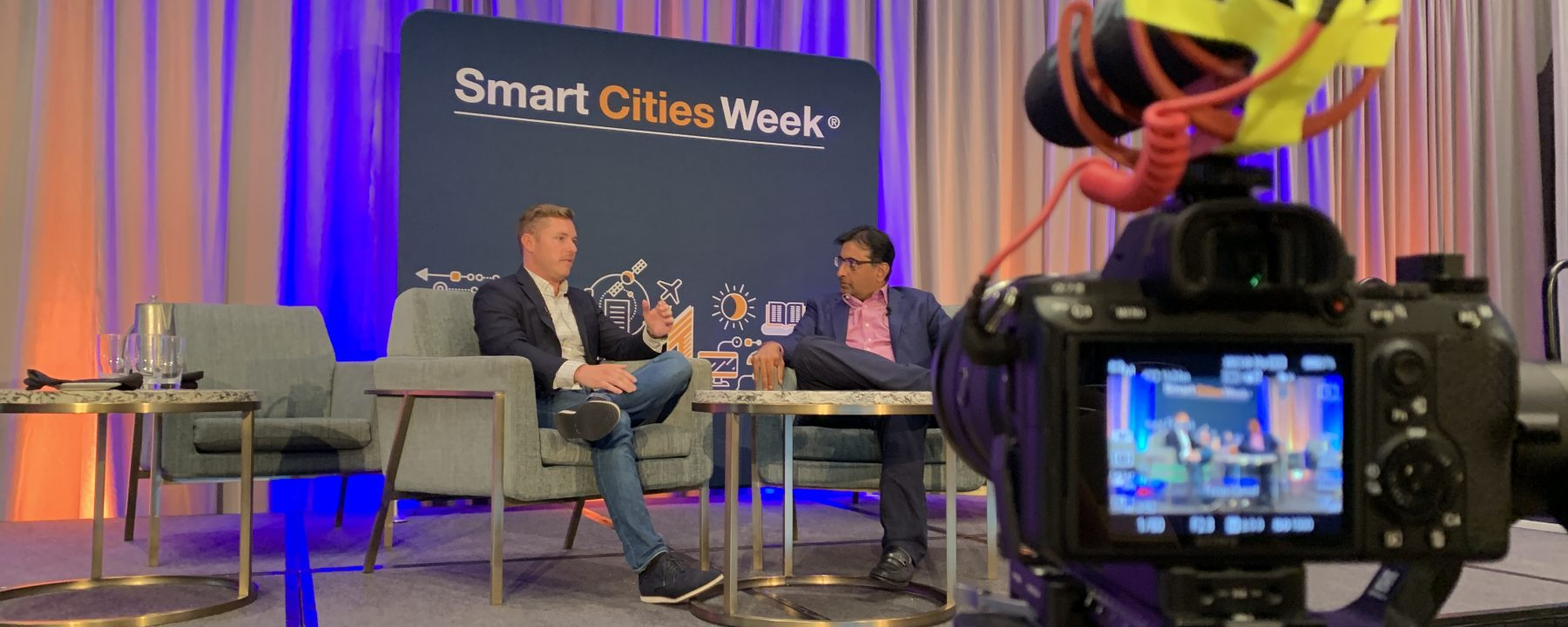 Going Green CEO Dylan Welch interviewing sustainable leaders at Smart Cities Week