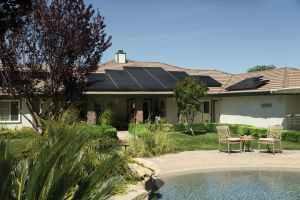 black solar panels on brown roof