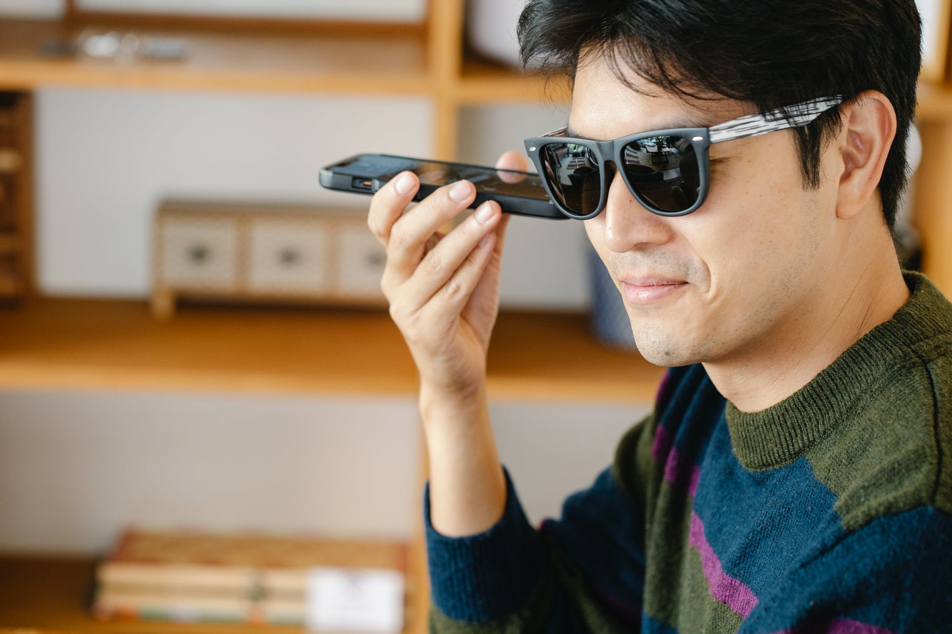man listening closely on his mobile phone
